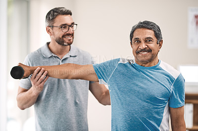 Buy stock photo Shot of a senior man exercising with dumbbells during a rehabilitation session with his physiotherapist