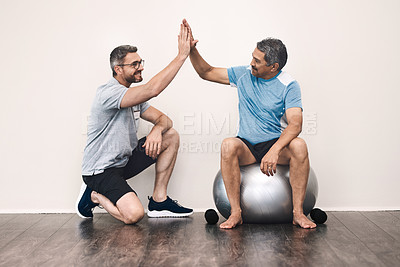 Buy stock photo Full length shot of a senior man getting a high five from his physiotherapist during a rehabilitation session