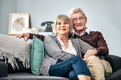 Buy stock photo Portrait of a happy elderly couple relaxing on a sofa together on the sofa at home