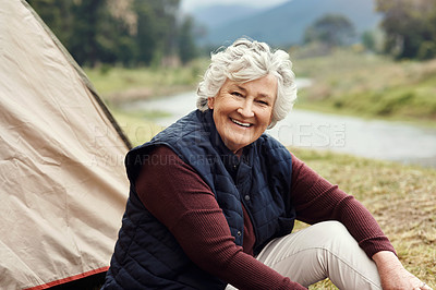 Buy stock photo Cropped portrait of a senior woman sitting outside of a tent on her chosen camping spot