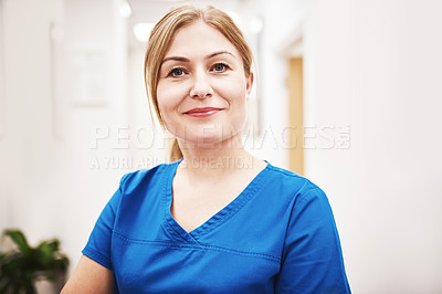 Buy stock photo Portrait of an attractive young female nurse at a clinic
