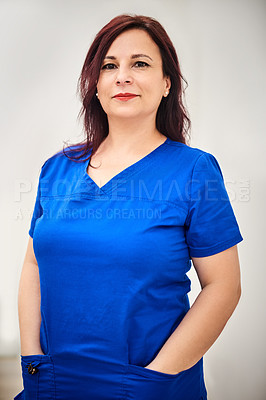 Buy stock photo Portrait of an attractive young nurse posing a grey background