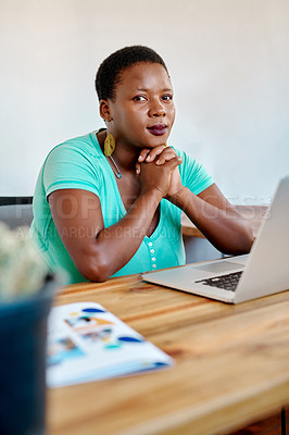 Buy stock photo Portrait of a young woman using a laptop while working from home