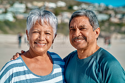 Buy stock photo Cropped portrait of an affectionate senior couple posing together while on the beach during the day