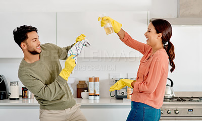 Buy stock photo Cropped shot of a happy young couple cleaning their home together
