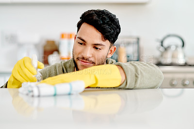 Buy stock photo Cropped shot of a handsome young man cleaning his house