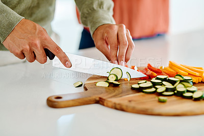 Buy stock photo Cropped shot of an unrecognizable man chopping vegetables
