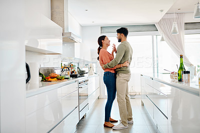 Buy stock photo Cropped shot of a young couple dancing in their kitchen