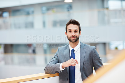 Buy stock photo Portrait of a confident young businessman standing in an office