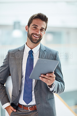 Buy stock photo Portrait of a young businessman using a digital tablet in an office
