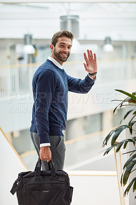 Buy stock photo Portrait of a young businessman waving while carrying a bag