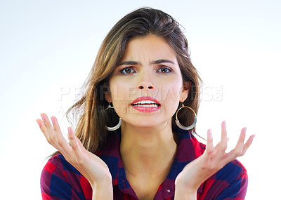 Buy stock photo Portrait of a young woman looking displeased against a white background