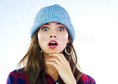 Buy stock photo Studio shot of a beautiful young woman gasping against a white background