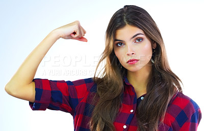Buy stock photo Cropped shot of a young woman flexing her muscles against a white background