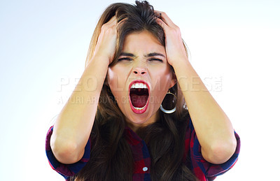 Buy stock photo Studio shot of a young woman shouting against a white background