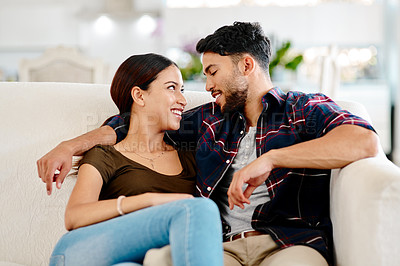 Buy stock photo Shot of an affectionate young couple spending some quality time together at home