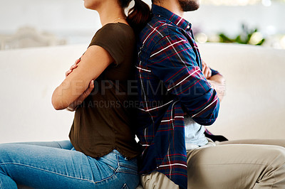Buy stock photo Shot of an unrecognizable couple sitting on the floor with their backs facing each other at home