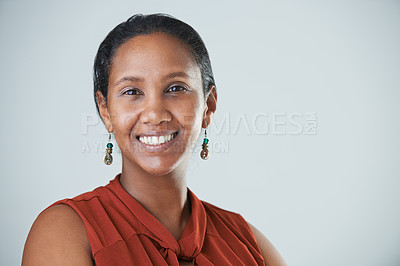 Buy stock photo Cropped studio portrait of an attractive mature woman standing and smiling against a gray background