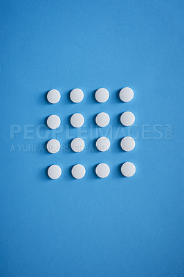 Buy stock photo Studio shot of tablets arranged in the shape of a square against a blue background