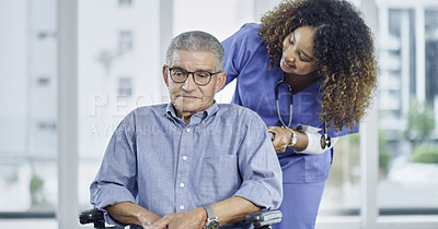 Buy stock photo Cropped shot of a female nurse assisting a senior man in a wheelchair