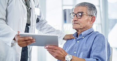 Buy stock photo Cropped shot of a doctor showing her senior patient something on a digital tablet