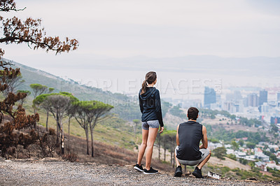 Buy stock photo Rearview shot of a sporty young couple looking at the view while exercising together outdoors