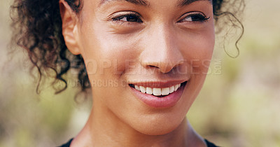 Buy stock photo Closeup shot of a sporty young woman looking positive while out for a run