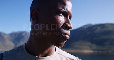 Buy stock photo Closeup shot of sporty young man looking determined while out for a run