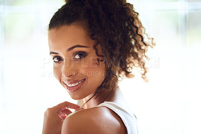 Buy stock photo Cropped portrait of an attractive young woman posing in her bedroom at home