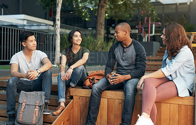 Buy stock photo Shot of a group of young men and women hanging out together on campus