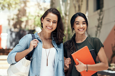 Buy stock photo Portrait of two young women hanging out together on campus outside
