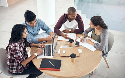 Buy stock photo Shot of a group of young men and women studying together at college