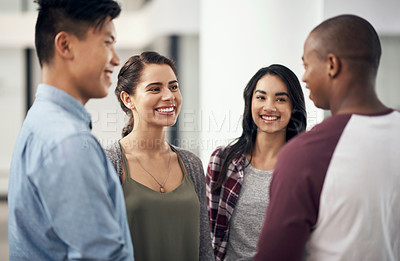 Buy stock photo Shot of a group of young men and women chatting during a break at college
