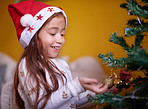 Children have so much fun decorating a Christmas tree