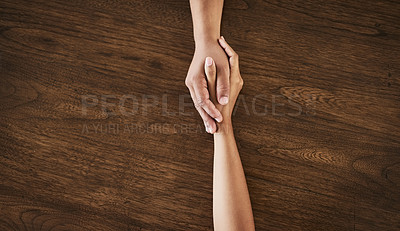 Buy stock photo Cropped shot of an unrecognizable man and woman holding hands at a table