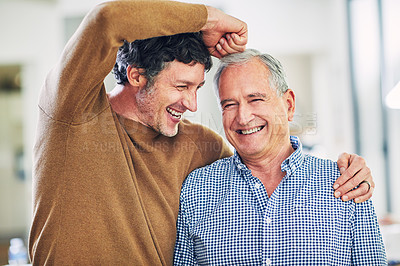 Buy stock photo Shot of a mature man and his elderly father having having a playful moment at home