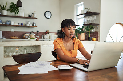 Buy stock photo Shot of a young woman sitting with her laptop and paperwork at home
