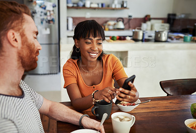 Buy stock photo Cropped shot of a young couple enjoying breakfast at home