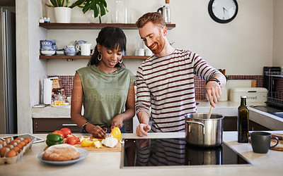 Buy stock photo Cropped shot of a young couple cooking at home