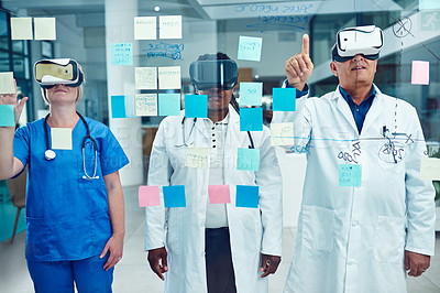 Buy stock photo Cropped shot of three medical practitioners wearing vr headsets while working in their hospital