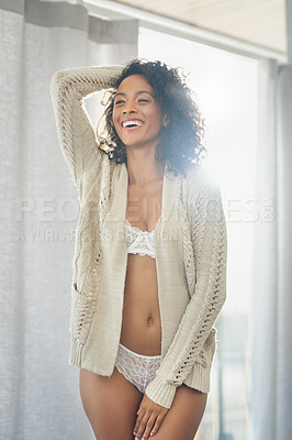 Buy stock photo Cropped shot of a gorgeous young woman standing with her hand on her head while wearing lingerie in her bedroom