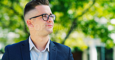 Buy stock photo Cropped shot of a handsome young businessman looking away and contemplating while standing outside during the day