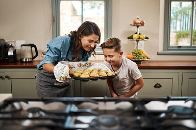 Buy stock photo Shot of a woman and her son baking together in the kitchen at home