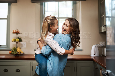 Buy stock photo Cropped shot of a young woman spending quality time at home with her daughter