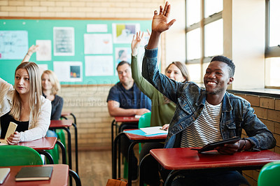 Buy stock photo Shot of a young man raising his hand in a classroom at college
