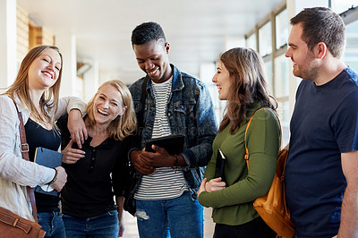 Buy stock photo Shot of a group of young men and women studying together at university