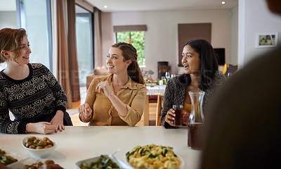 Buy stock photo Shot of young friends having lunch at home