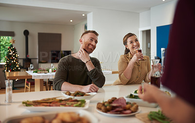 Buy stock photo Cropped shot of friends having lunch at home