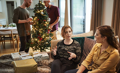 Buy stock photo Shot of young friends having a get together at home during Christmas