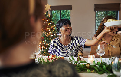 Buy stock photo Shot of young friends having Christmas lunch at home